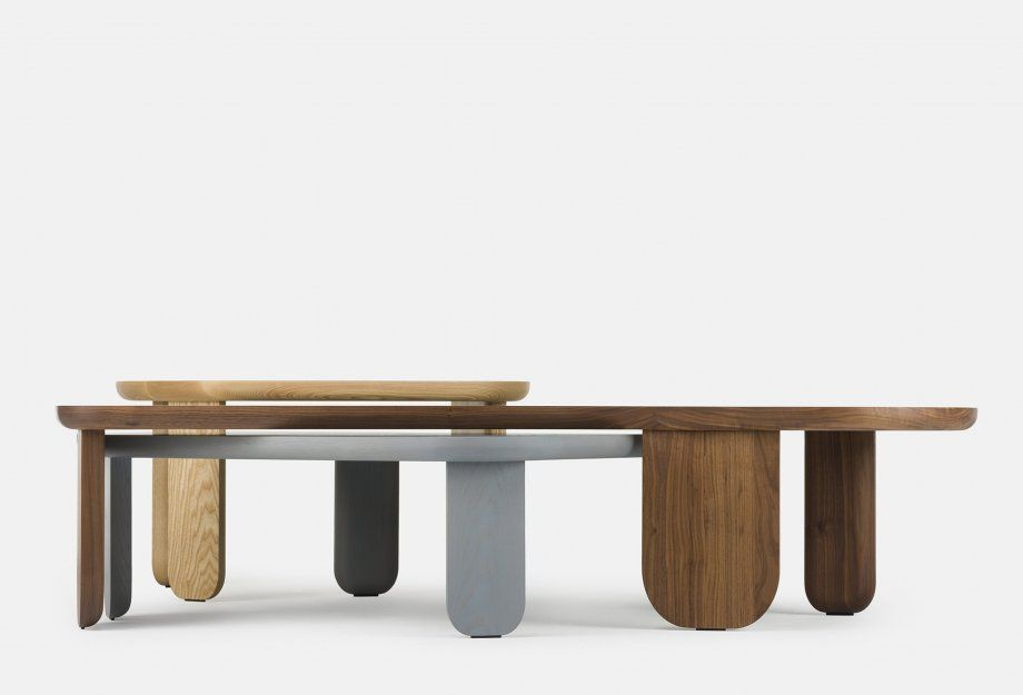 A collection composed of a side table, coffee table, and bench, all ...