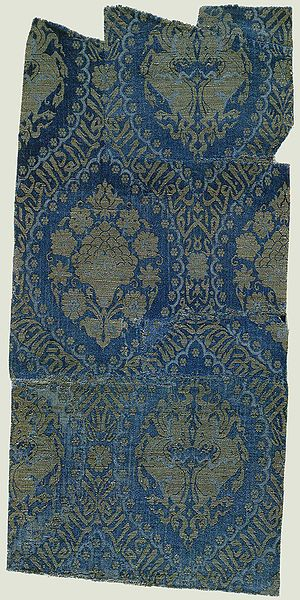 "piece of silk, Persia, 14th century. Silk. ""Musterrapport"" 46.3:22.8 cm. Size of the whole piece: 71.6 cm x 34.2 cm. Bayrisches Nationalmuseum, Munich, Inv-no. T 102. The inscription reads ""Fame to our lord, the sultan, the wise, the just, whose victory has been praised"". Maybe intended as a present to Mamluk sultan Mohammed Nasir Eddin (d. 1340)"