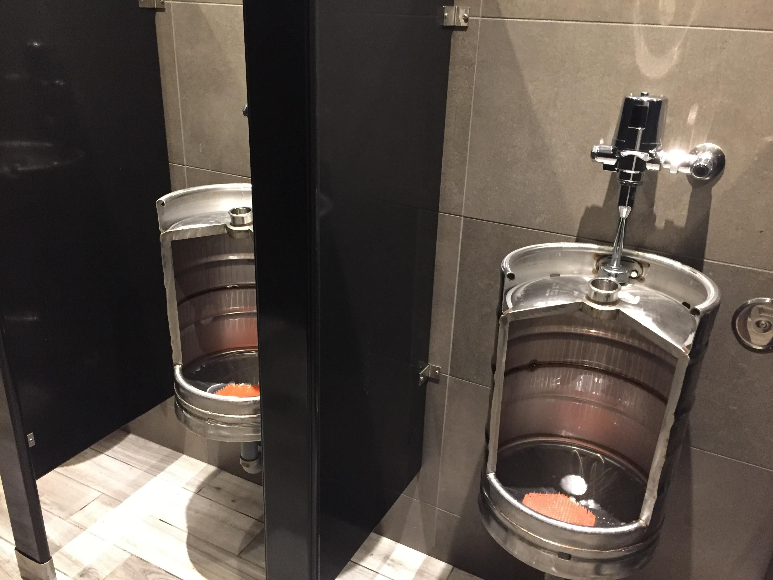 This bar's urinals are made from old beer barrels