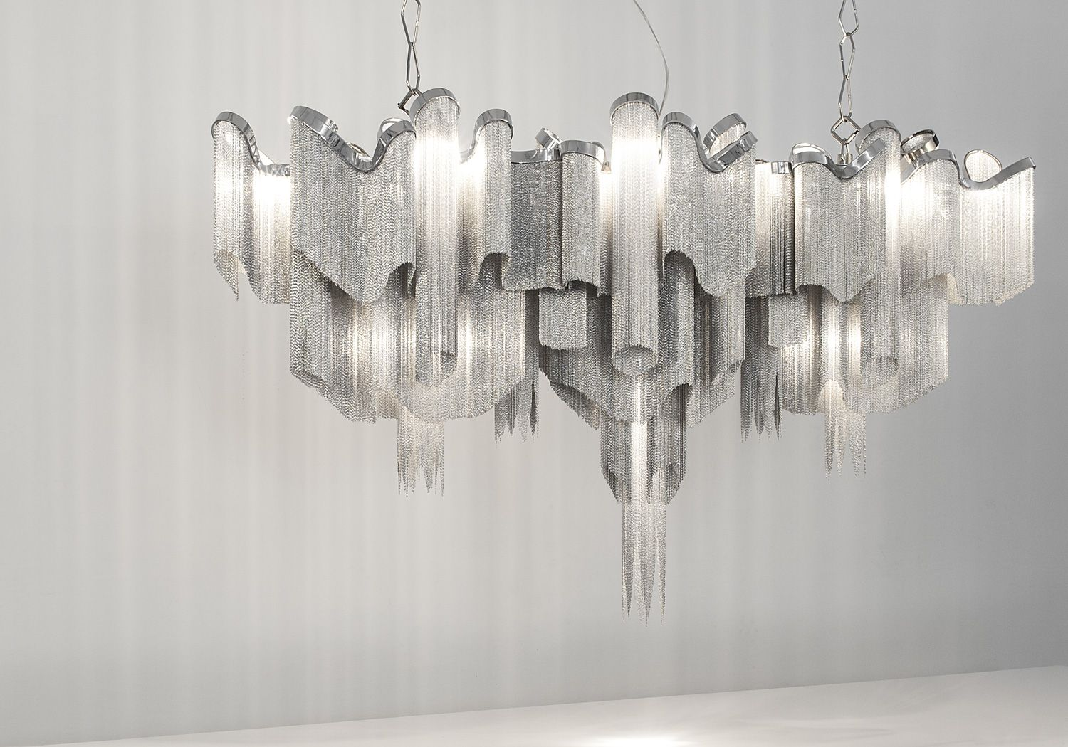 Terzani - Stream Iridiscent Light  TOP 10 MOST BEAUTIFUL AND TRENDY SUSPENSION LAMPS OF 2014  #decorationlovers, #Design, #toplighting #ARCHITECURE #CHANDELIERBEST #CHANDELIERSOF2014 #BESTSUSPENTIONLAMPSOF2014   Follow: http://decorationlovers.com/ https://www.facebook.com/decorationlovers?fref=ts