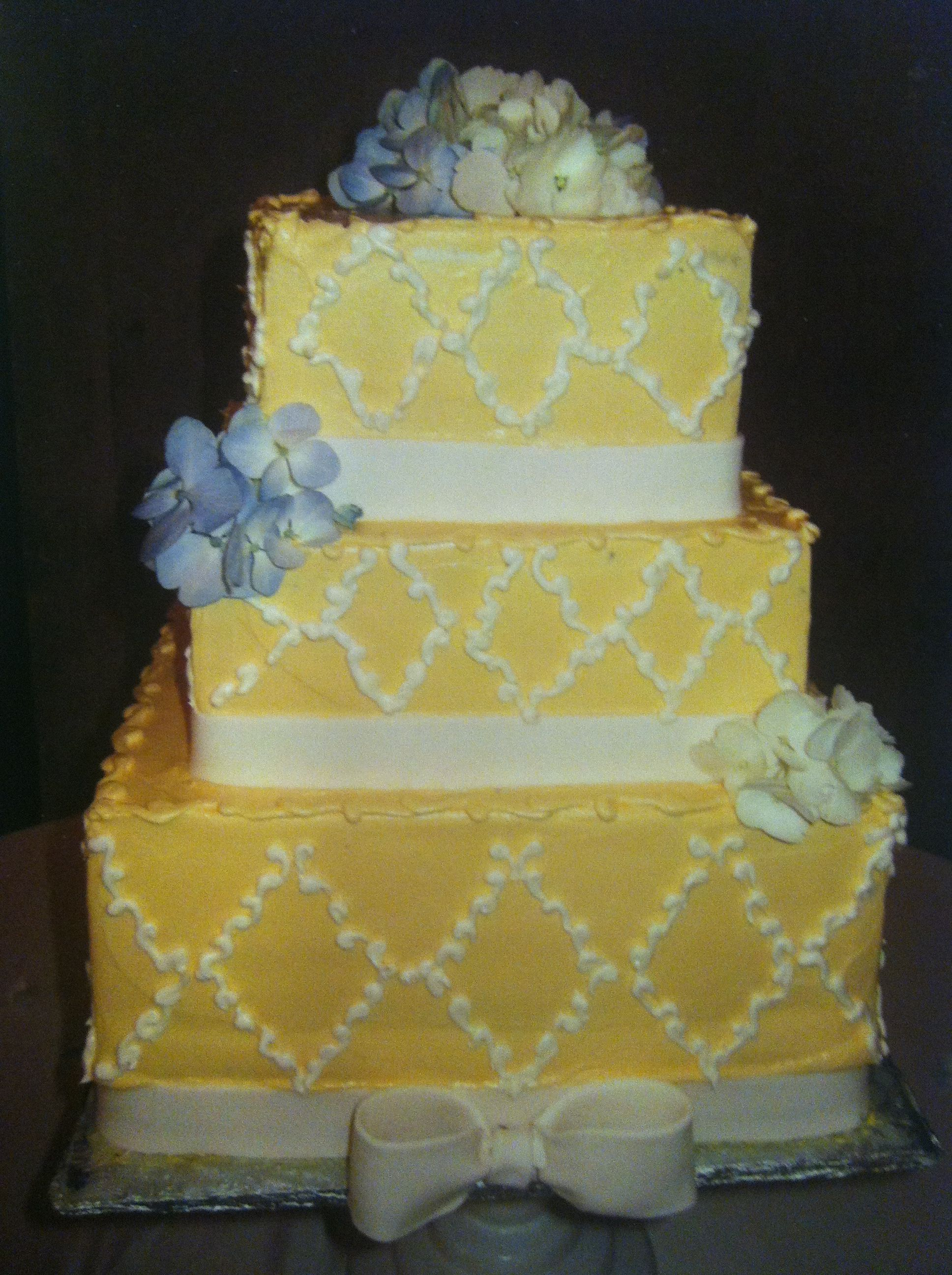 yellow square wedding cake with diamonds piped on and fondant ribbon ...