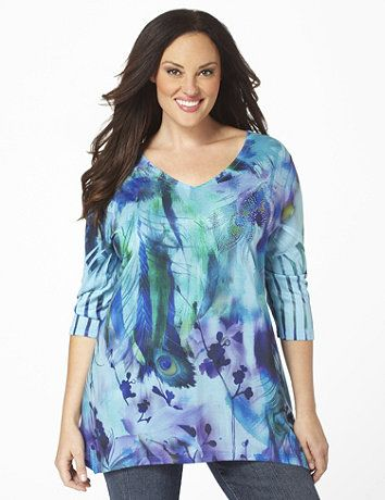 Lightweight V-neck tunic comes in a dreamy, peacock print accented with tiny rhinestones. The three-quarter sleeves feature intricate folds. Asymmetrical hem falls longer on each side for a flattering finish. Catherines tops are perfectly proportioned for the plus size woman. sonsi.com