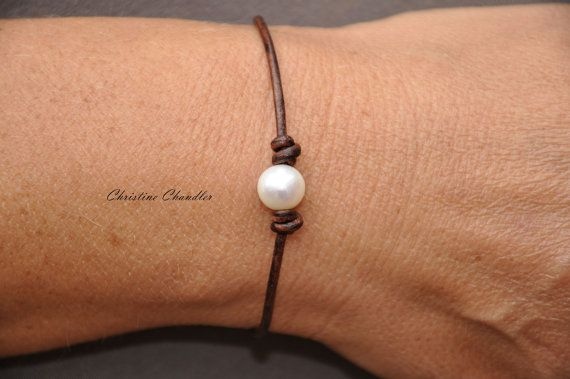 A must have for everyone. A Pearl and Leather One Pearl Bracelet. Choose your leather color, and choose a White Pearl or Peacock Pearl. I use high quality 10mm pearls, and I will make the bracelet 7 inches unless you specify a different size. The clasp is solid Stainless Steel as well as being magnetic with a turn lock.  A great start or addition to your Pearl and Leather Jewelry Collection.  * The bracelet in the photo has sold, but represents the bracelet that you will receive.