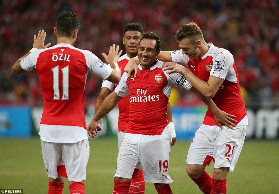 Captain for the day Cazorla is mobbed by his Arsenal team-mates as the Spanish midfielder celebrates scoring the 2nd goal of the game against Everton in the Asia Trophy July 2015