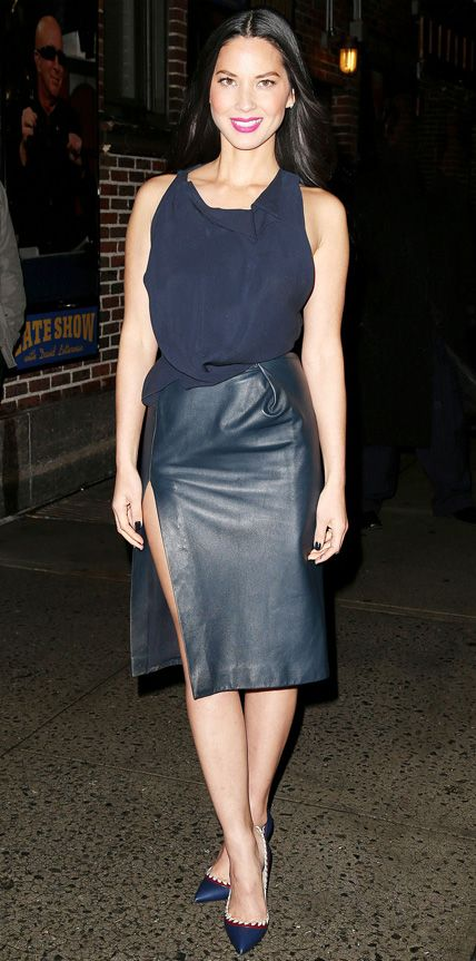 For an appearance on the Late Show with David Letterman, Olivia Munn selected a navy sleeveless top with origami detailing at the neckline, tucked into a sexy leather pencil skirt with a dangerously high slit. A bold fuchsia lip and playful pumps completed her look.