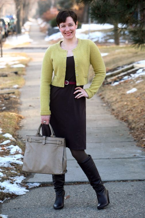 Cropped cardigan, belt, brown dress, tights, and boots