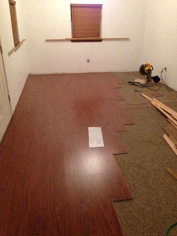 marvelous carpet covering #5: DIY laminate flooring over existing carpet. Our new retail space had old  dirty Berber carpet