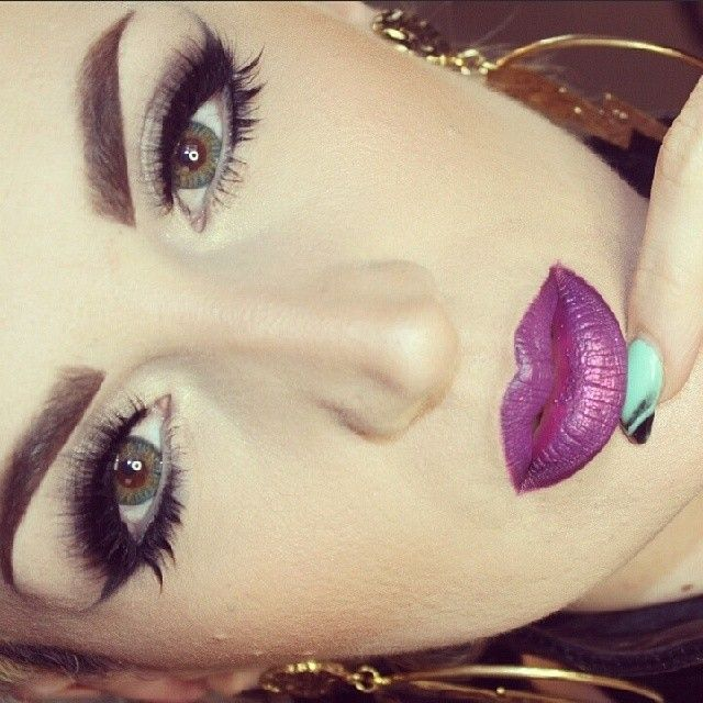 purple lips and defined eyes