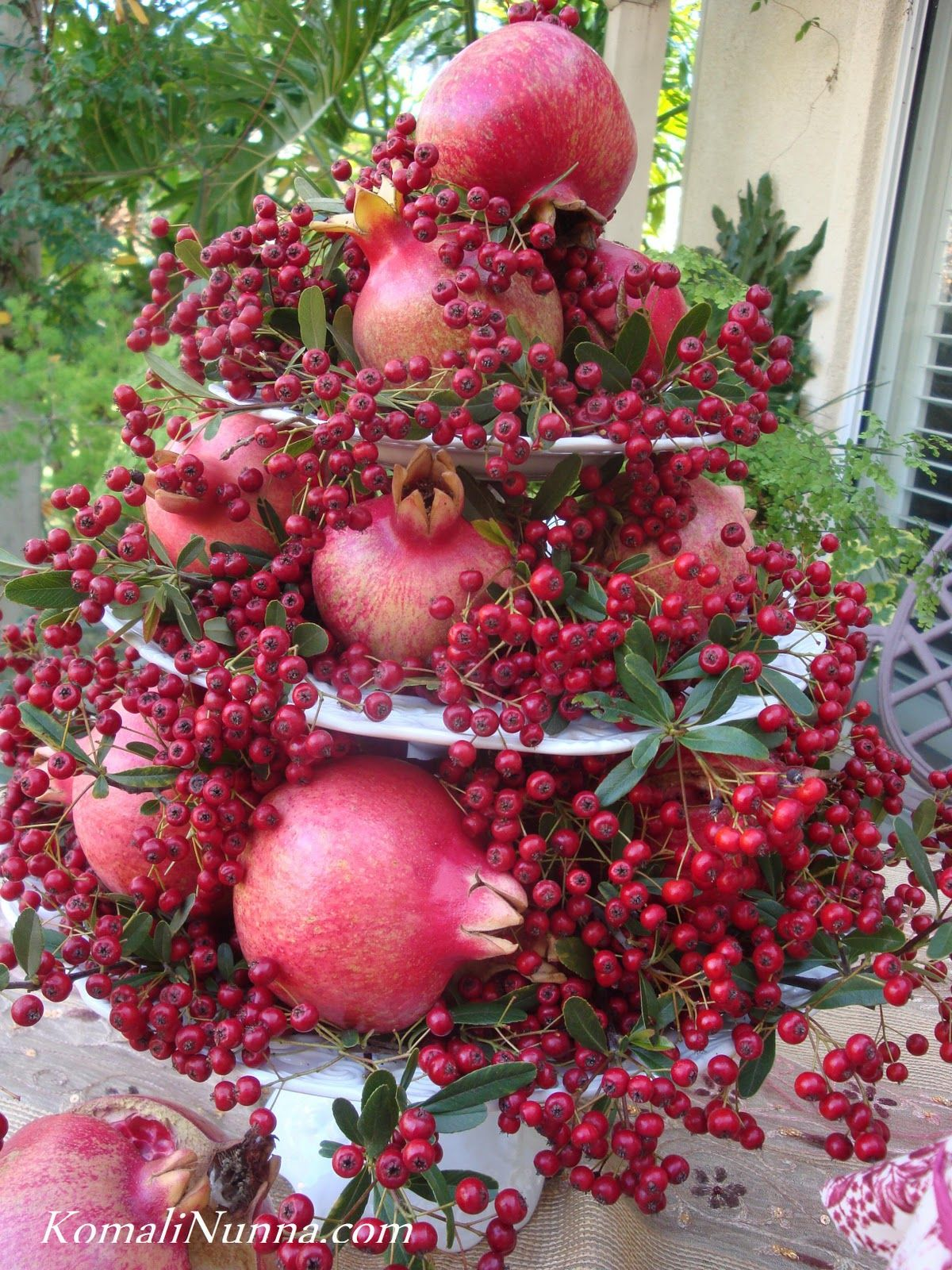Christmas buffet table decoration ideas - Pomegranate In Flower Arangements Pomegranates And Berries From The Garden Make A Stunning Centerpiece Christmas Table Decorationschristmas Decorating