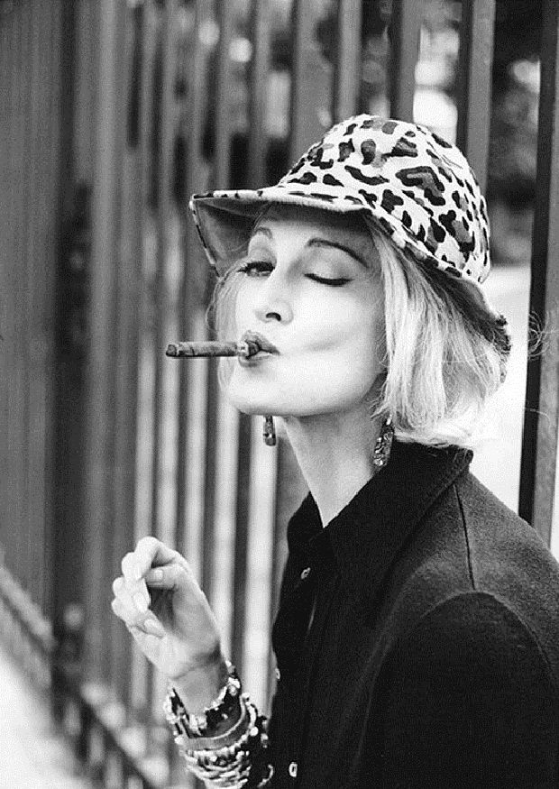 Carmen dell'Orefice smoking a cigarette (or weed)