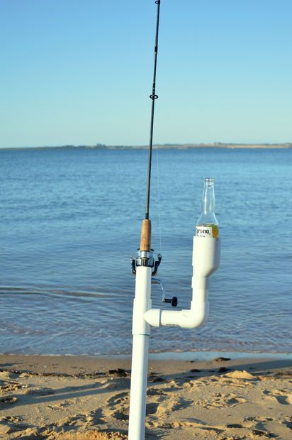 Ultimate fishing rod holder fly fishing fish and ocean for Best pier fishing rod