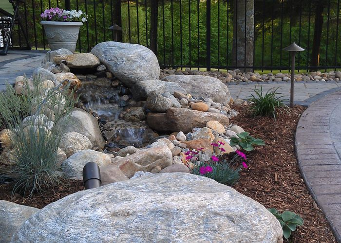Small Water Feature Beside A Patio In Ellington Ct Installed By Bahler Brothers