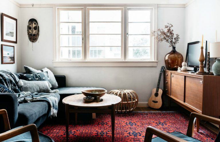 an effortlessly stylish secondhand house  living room red