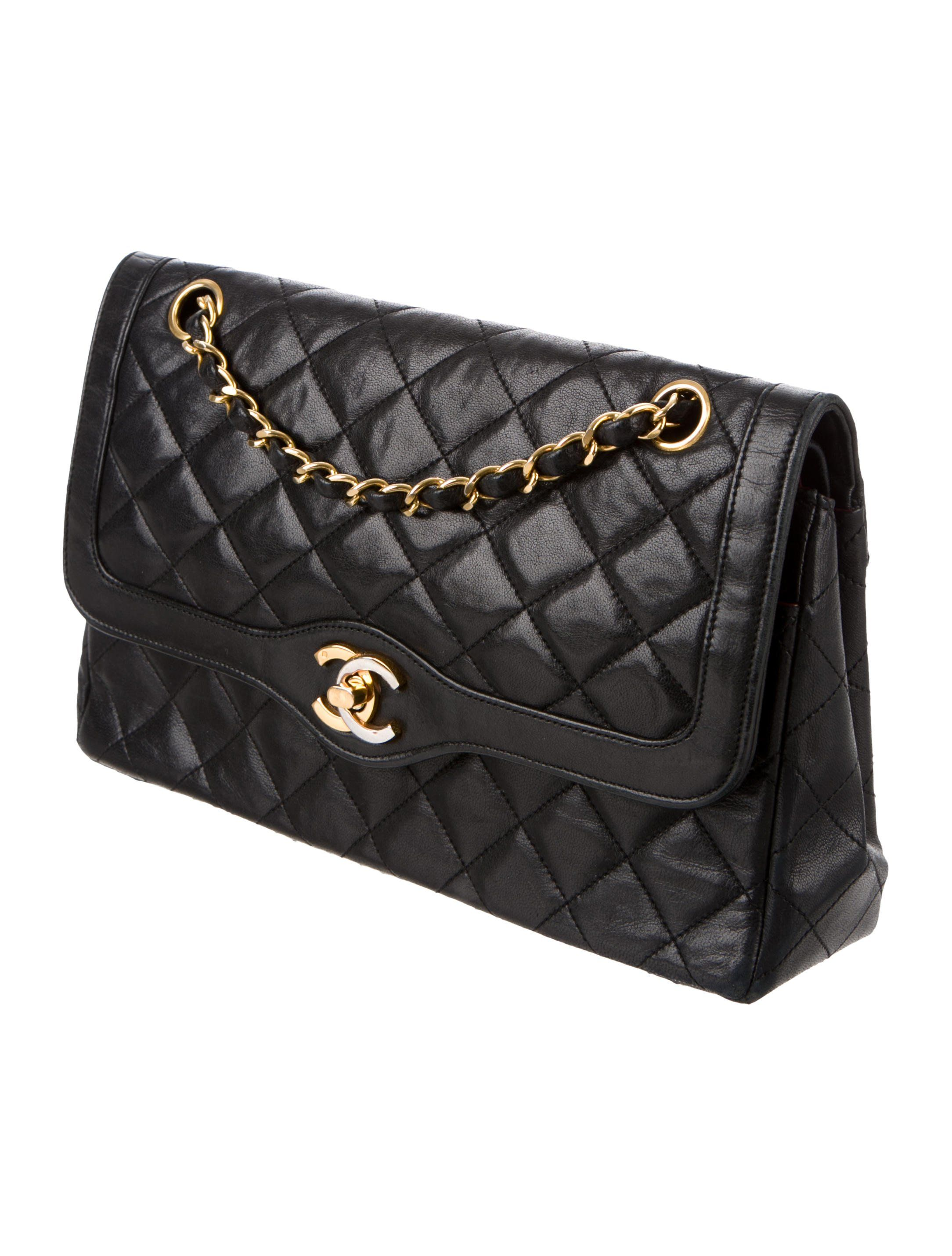 4f45b0ed328f73 Black quilted lambskin Chanel Vintage Paris Double Flap Bag with gold-tone  hardware, tonal stitching, logo at exterior, single pocket at back, single  chain-