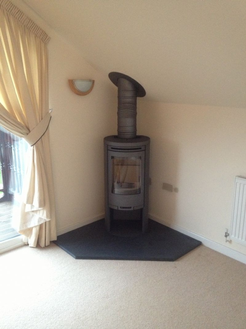 A Contura 556 Installed Into A Corner On A Bespoke Honed