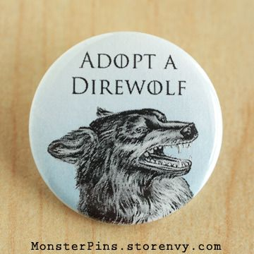 Game of Thrones.  Direwolf.  Get your own, here: http://www.storenvy.com/products/3503942-adopt-a-direwolf-game-of-thrones-pinback-button-house-stark-pin-wolf-bad