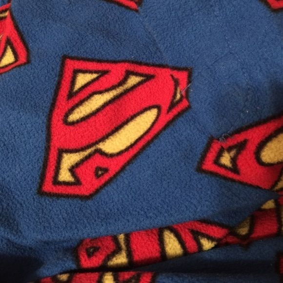 super man pajamas pants ! I shop in the men's section for pajamas, never worn by a guy lol nice comfy cozy material!! Perfect for those cold nights... Listed as X large but I'm a medium and they fit me perfectly Intimates & Sleepwear Pajamas