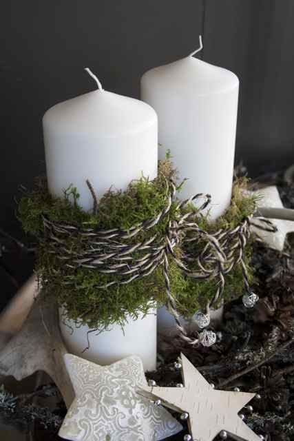 winter white candles with moss and twine