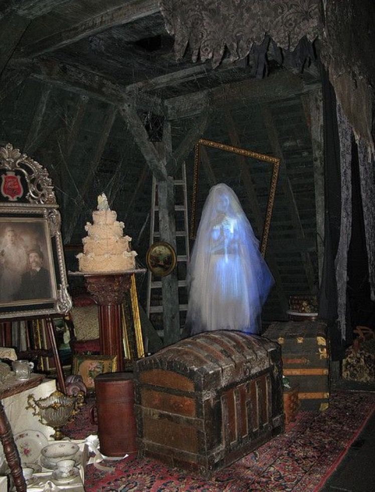 The Haunted Mansion bride in her attic, lights on.