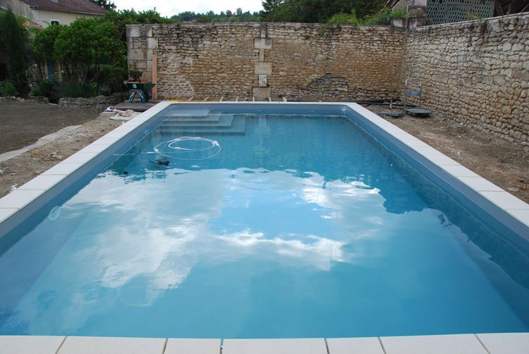 How do you find and repair a leak in a swimming pool