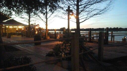 The Villages boardwalk at Sumter Landing at dusk.