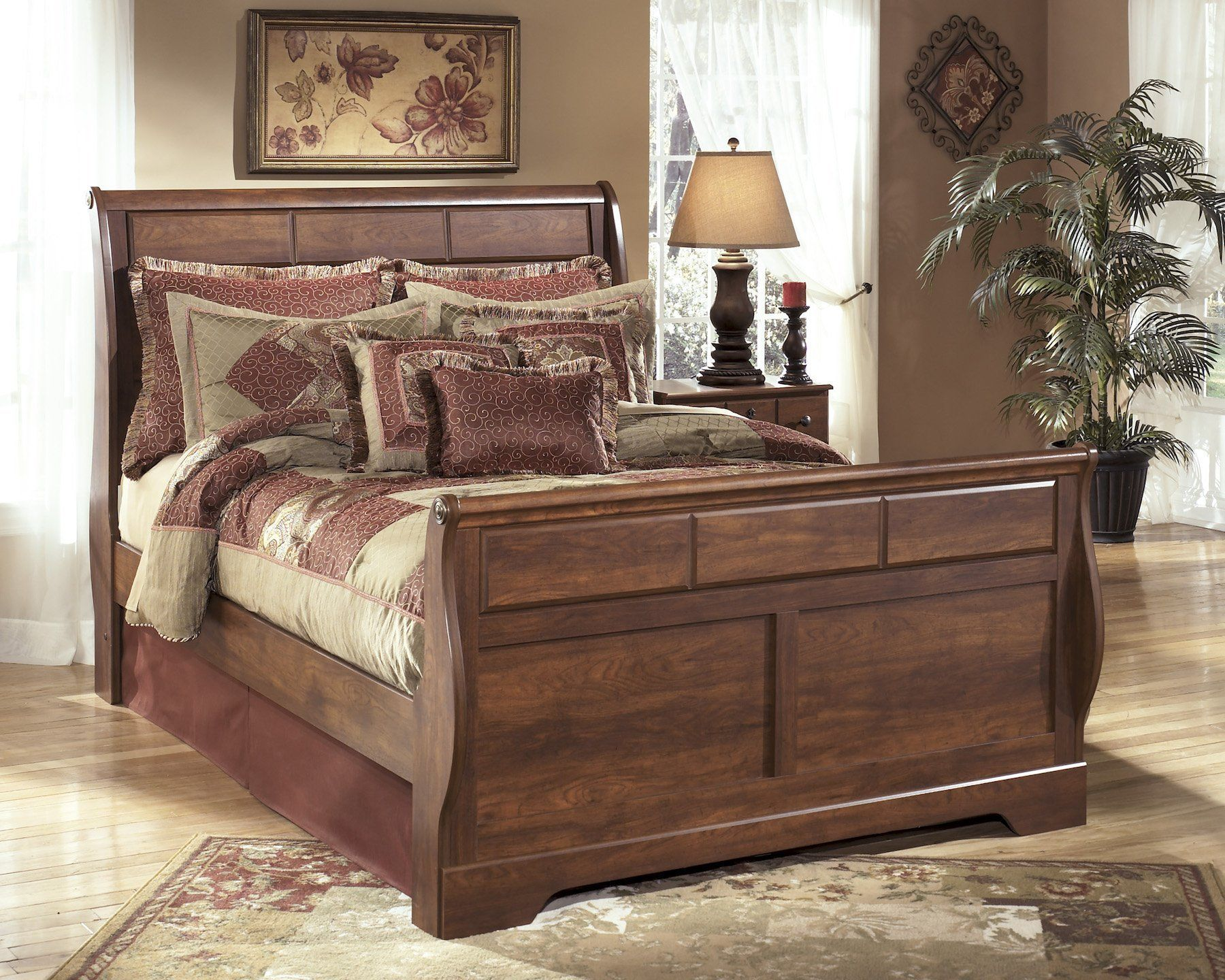 ashley timberline queen sleigh bed in warm brown want to know