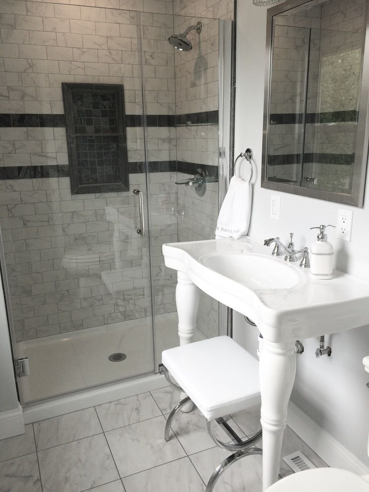 Transitional-Style Master Bath by BlankSpace LLC, Pittsburgh PA. Walk-in Shower with Marble-Look Porcelain Subway Tile and Quartzite Accents; White Porcelain Console Sink