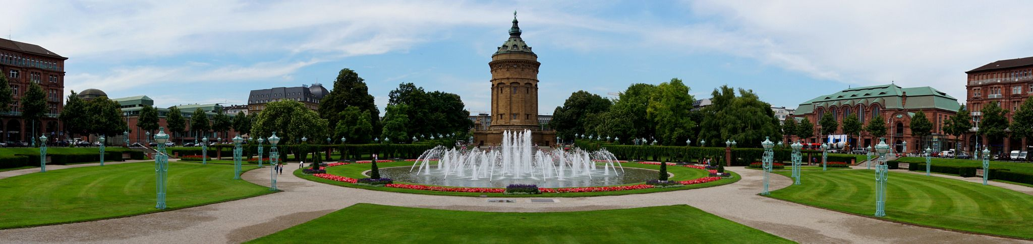 https://flic.kr/p/pYPm8B   Mannheim panorama   Mannheim architecture panorama, fountains surrounding the Wasserturm (water tower) in the center of Mannheim