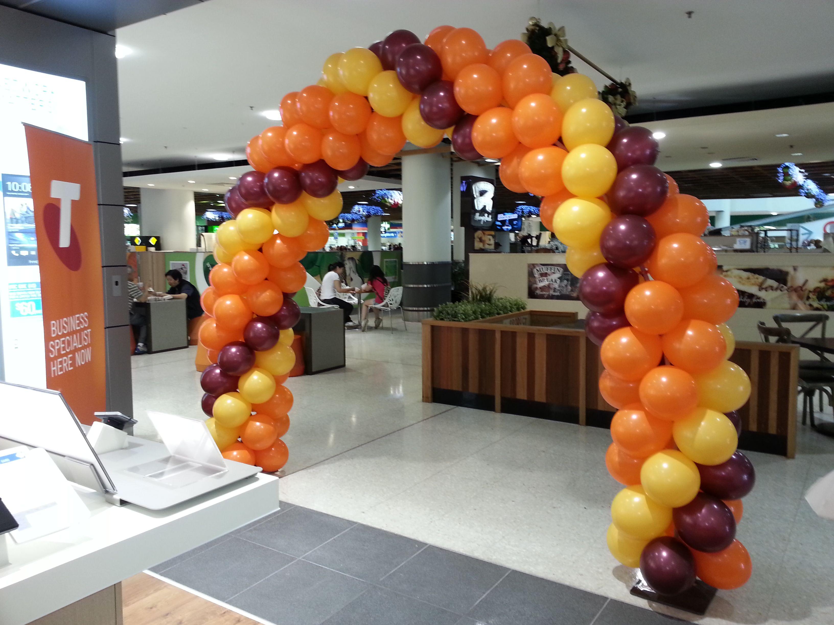 Orange Goldenrod and Burgundy arch for Telstra
