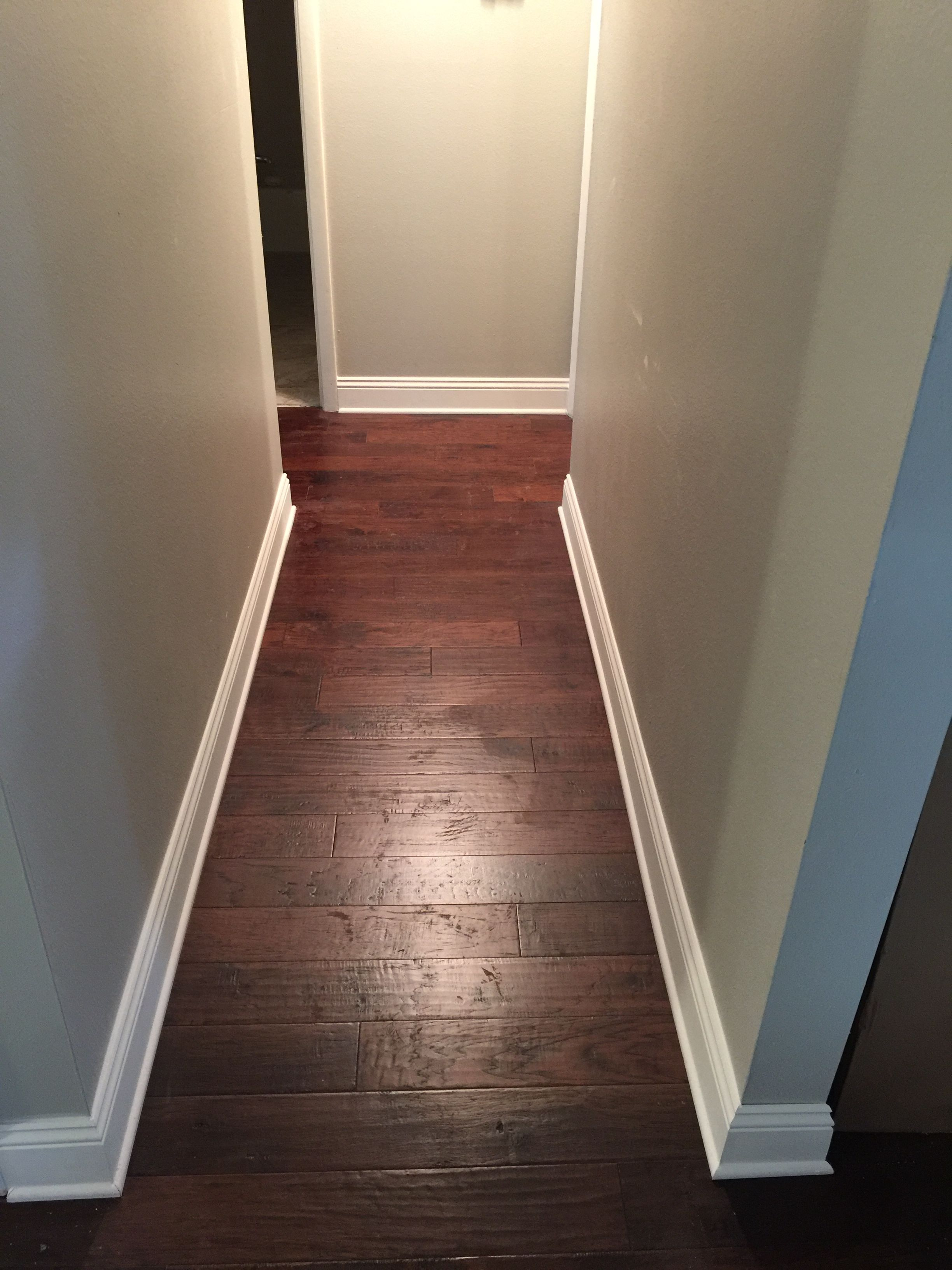 5 Inch Baseboards Are So In Right Now Remodeled This Hallway With Dark Hardwood Floors Condo Kitchen Remodel Kitchen Remodel Layout Simple Kitchen Remodel