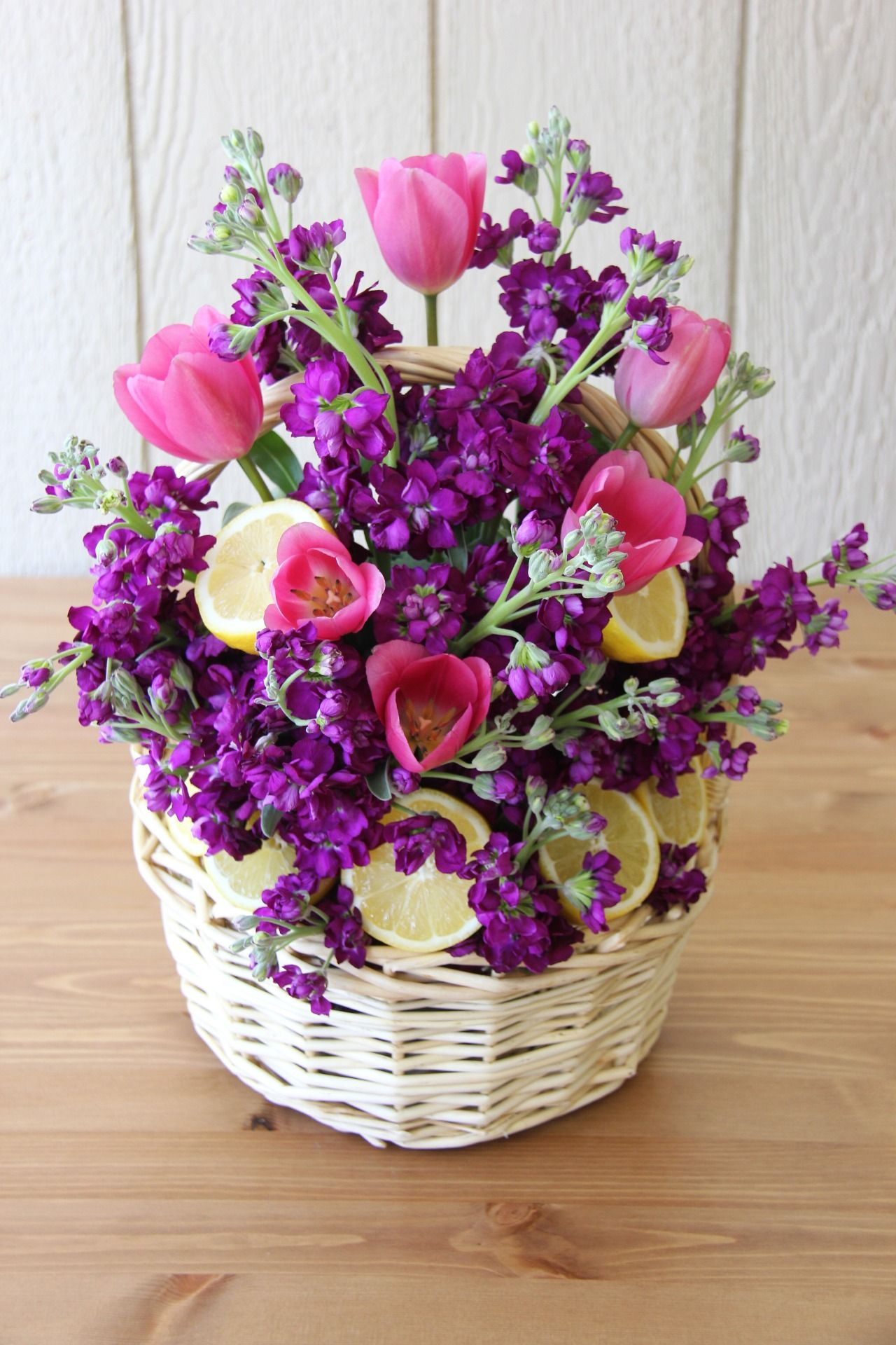 Mothers day flower basket with lemons this basket makes a beautiful mothers day flower basket with lemons this basket makes a beautiful centerpiece for mothers day brunch it combines deep pink and purple flowers with izmirmasajfo
