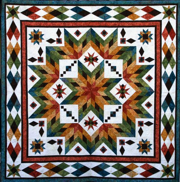 Taos Pattern Quilting By The Bay In Panama City Florida Featuring Custom Block Of The Month Quilt Patterns