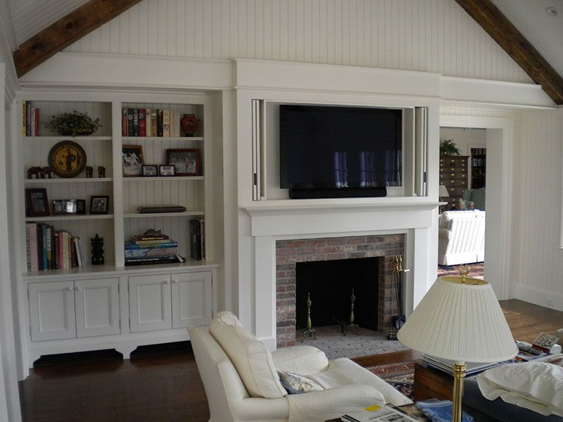 Built in window seat & bookcase around fireplace in family room ...
