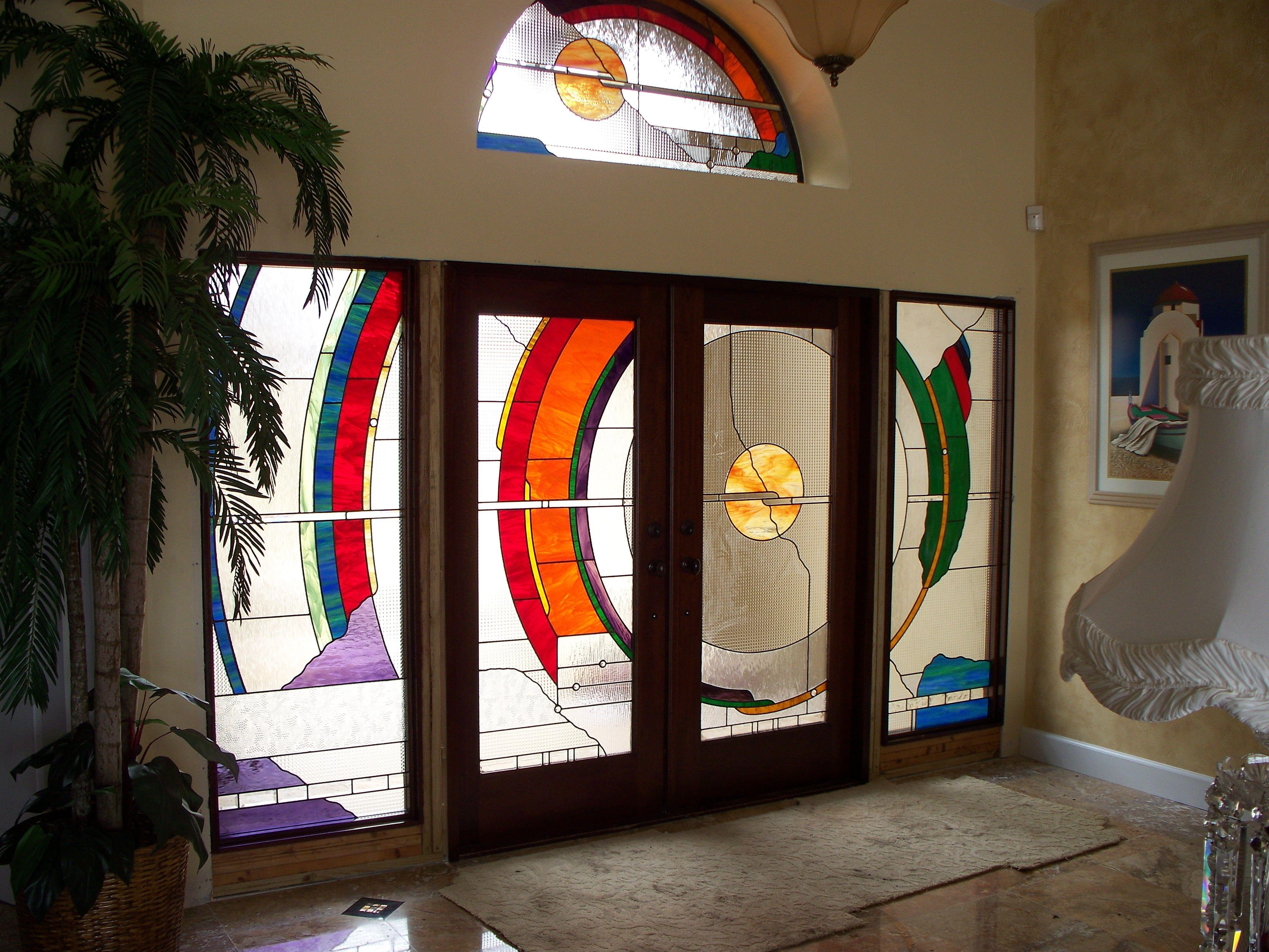 Custom entry created by Designer Art Glass in Daytona Beach Fl. We made the custom mahogany doors. 386 673 8604 or 407 328 8683