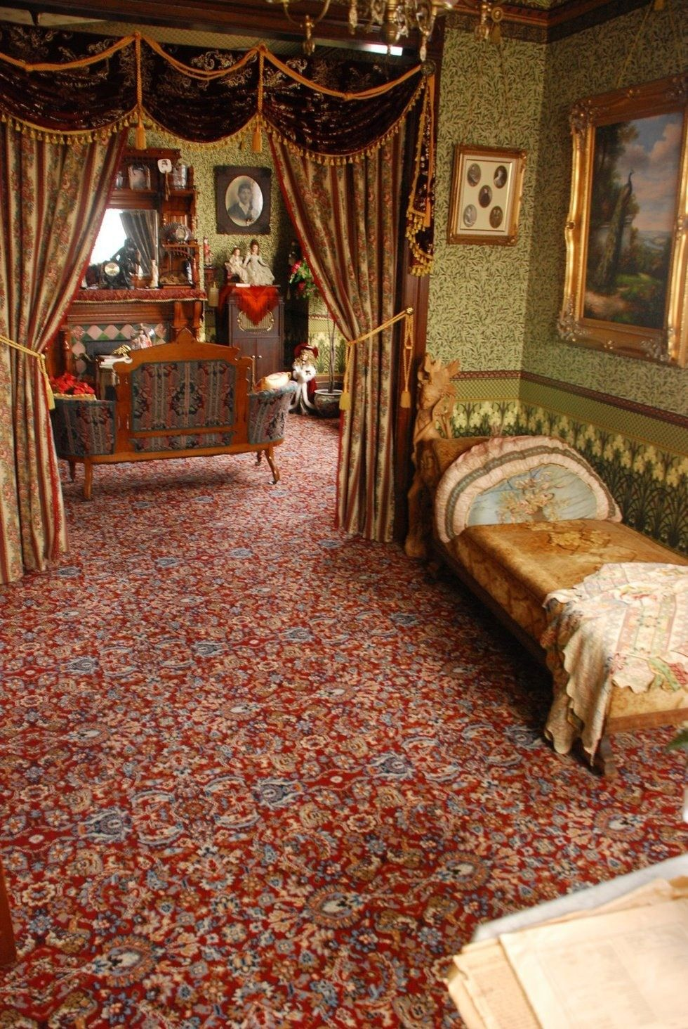 love the lush fabric and swags....love the pillow on fainting couch...