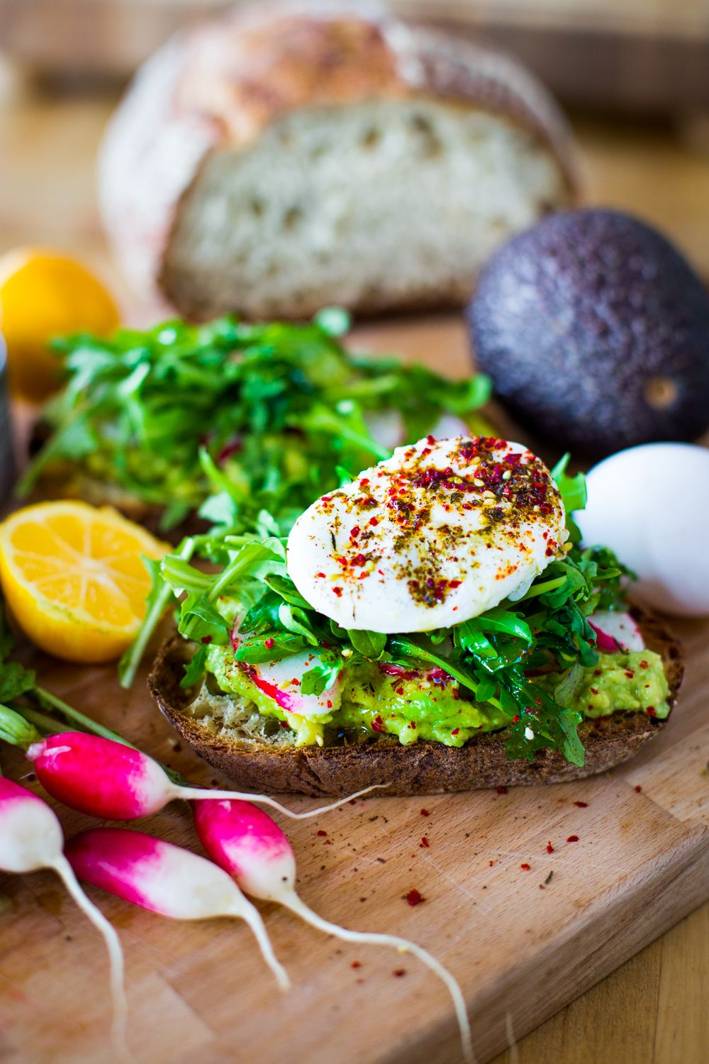 A simple tasty recipe for Avocado Toast with Poached Eggs, arugula, zaatar, lemon and radishes. Quick and delicious ...and healthy!