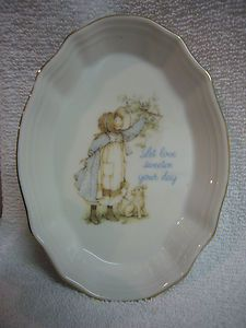 "Decorative gold rim Holly Hobby collectible candy / centerpiece dish.  Awesome condition, says ""Let Love Sweeten Your Day"" Genuine Porcelain.  6 3/4"" long, 4 3/4"" wide, 1"" tall."