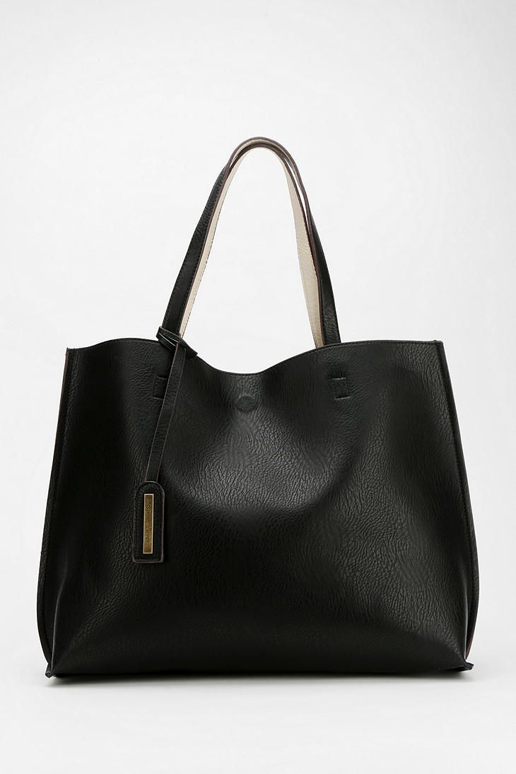 Reversible Vegan Leather Oversized Tote Bag - Urban Outfitters ...