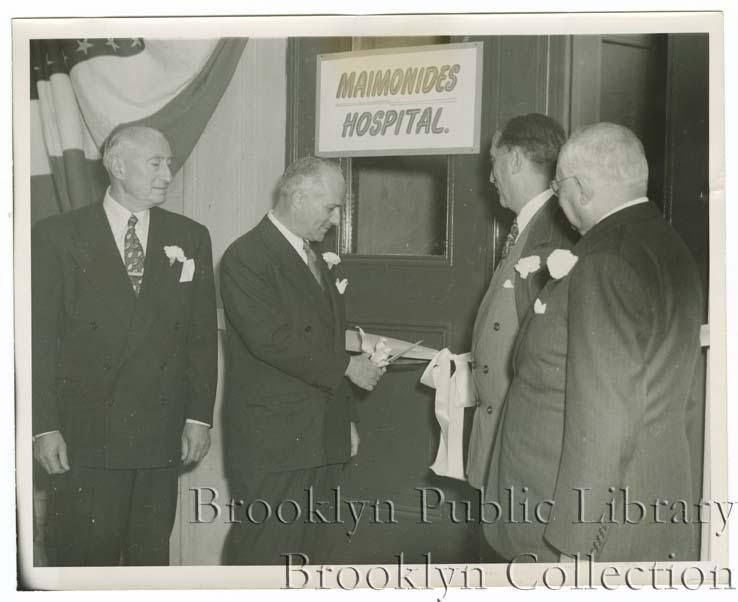 (1950): Ribbon cutting ceremony to mark the opening of a new eight-floor addition to Maimonides Hospital at 10th Avenue and 49th Street. Left to right: Hyman Portnoff, chairman of the building committee; Edward Neimeth, president of Maimonides Hospital; Ralph Samuel, president of the Federation of Jewish Philanthropies, and Morris Tartikoff, Assistant Attorney General of the State of New York.