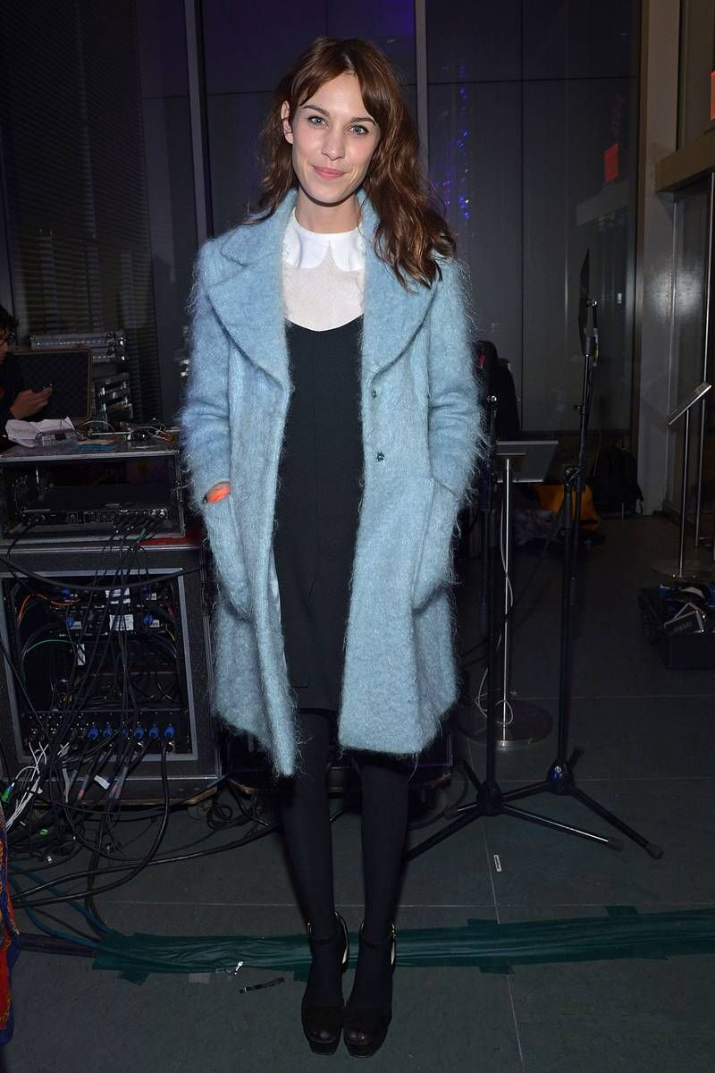 Alexa Chung attends The Armory Party at MOMA on March 6, 2013 in New York City.  long-sleeve Peter Pan blouse with a black spaghetti-strap dress. a soft, fuzzy powder-blue coat by Philosophy Di Alberta Ferretti and painted her nails to match.