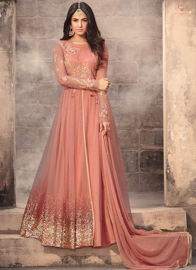 195ab6fe2672 Peach Embroidered Net Anarkali Suit features a beautiful net top alongside  a santoon bottom and inner. A chiffon dupatta completes the look.