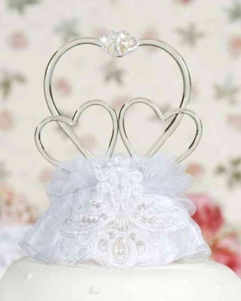 This classic cake topper features three artisan made blown glass ...