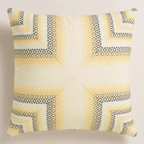 Soft yellow and gray hues make this pillow a versatile accent for the living room or bedroom. It features embroidered corners on the front and a striped back, giving you two design options in one.