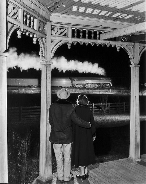 "Mr and Mrs Ben Pope watch the last steam-powered passenger train, Max Meadows, Virginia, 1957 by O. Winston Link, aka ""OWL"""