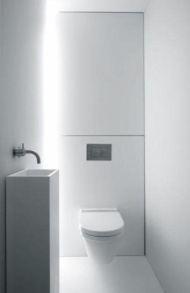 Beautiful white bathroom by Govaert  Vanhoutte Architects