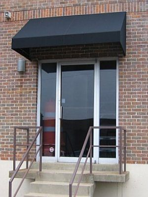 The crisp lines of this awning really dress up this commercial entrance and soften the brick & The crisp lines of this awning really dress up this commercial ...