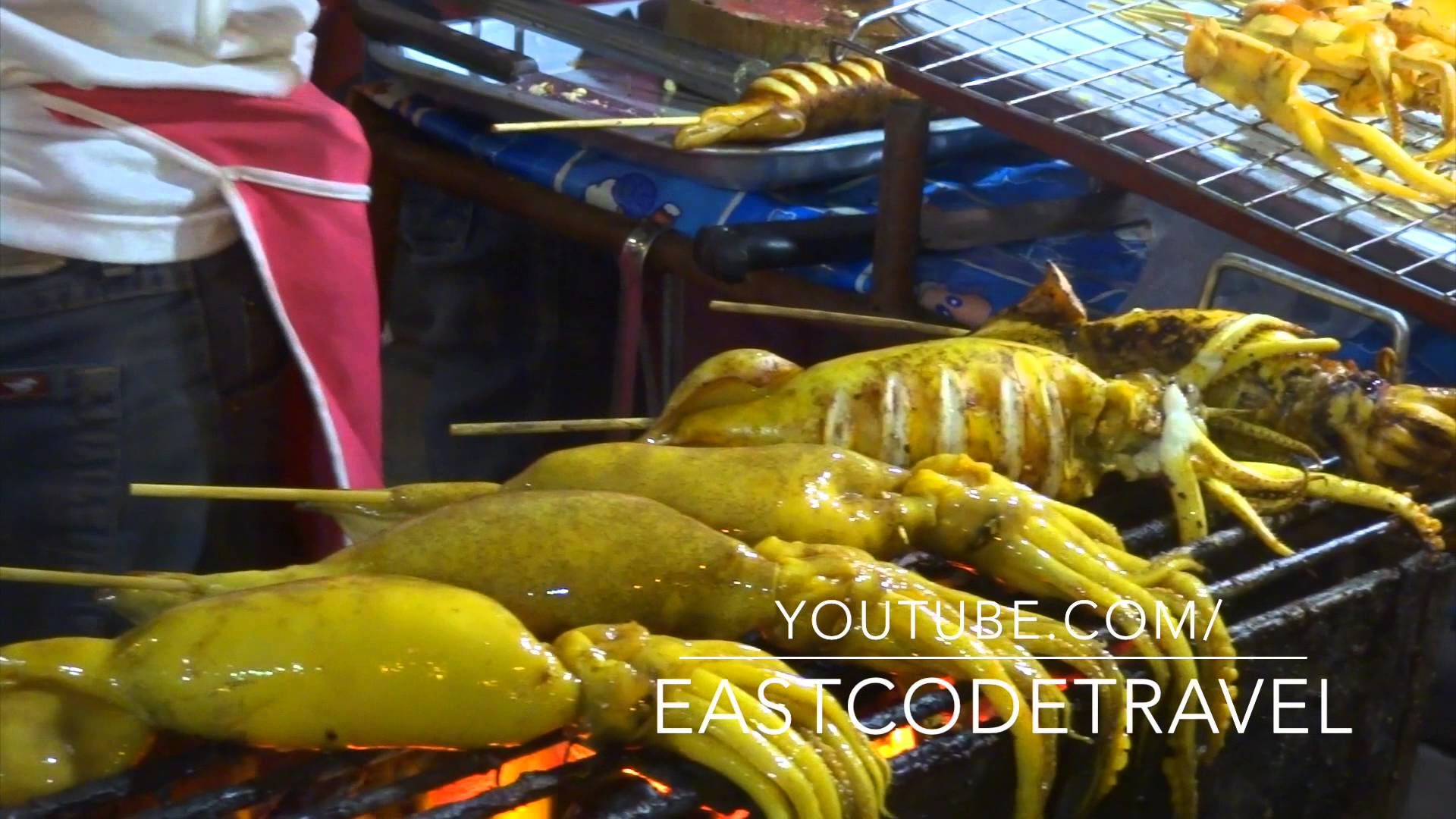grilled  whole squid with spicy sauce Thai street food