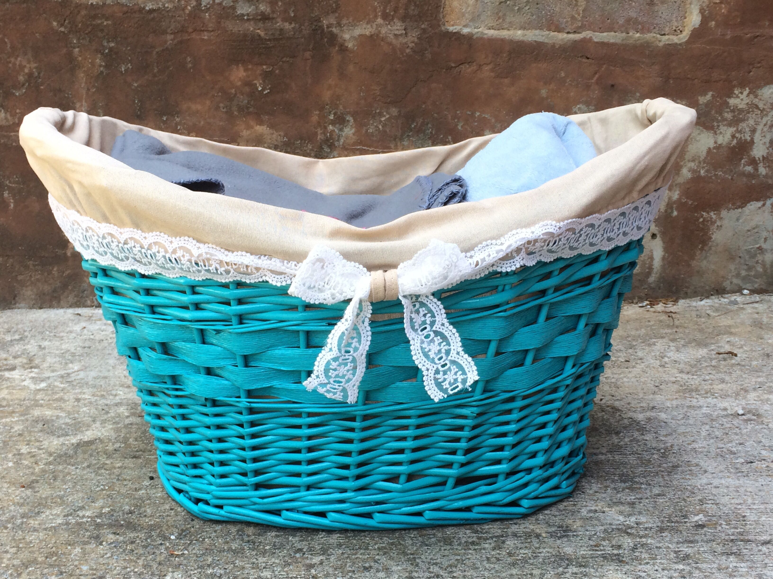 DIY Blanket Basket. Spray paint and add lace!