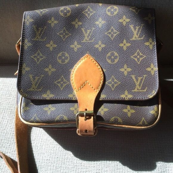 Authentic Louise Vuitton cartouchiere mm Very nice cross body bag. There are three separate sections inside. Keep your stuffs organized. Date code is 882SL. Size 8*7*2.8 inches. One of decorative button inside is missing, but doesn't affect usage, and also not noticeable. :) No❌trade Louis Vuitton Bags Crossbody Bags