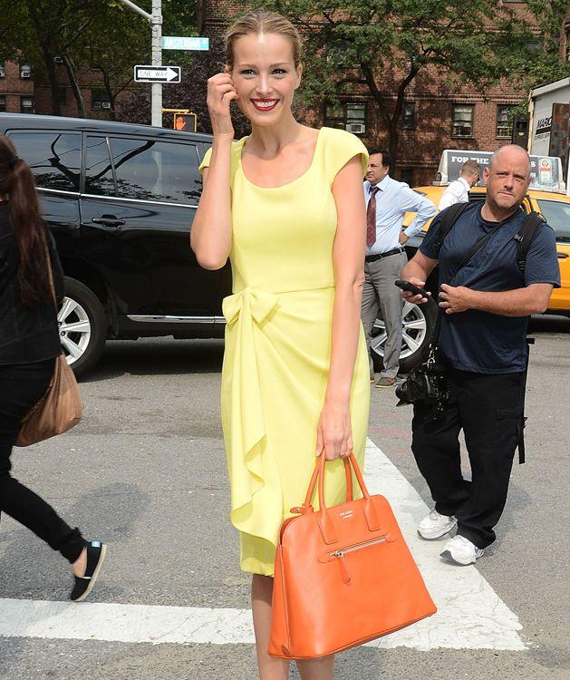 72eee08b2bfc Petra Nemcova carrying a Prada Saffiano Cuir Open Top Promenade Bag ...